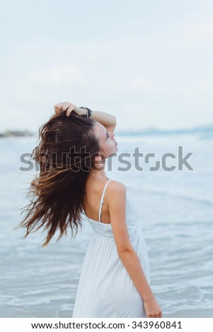 Outdoor,Beautiful sexy young woman brunette hair evening makeup wearing short dress suit top skirt,tropical island LA,California.walks summer fall collection,perfect outfit in ocean view, sun shine - stock photo