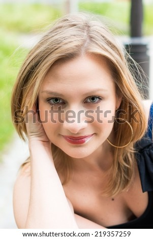 outdoor beautiful young woman having good time - stock photo