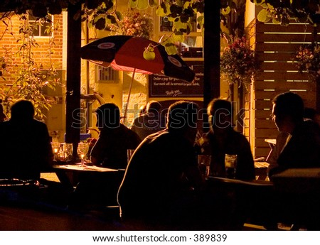 Outdoor beer garden on a summer's evening - stock photo