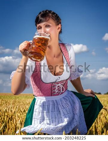 outdoor beergarden female drinking german jar - stock photo