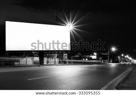 outdoor billboard and light on road in night time ,black and white tone