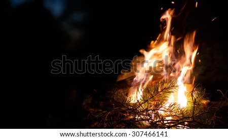 Outdoor bonfire with sparks - stock photo