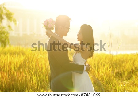 Outdoor Bride and Groom, surrounding by natural morning golden sunlight.