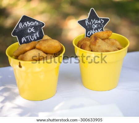 Outdoor Buffet, Meat and Fish Rissole in a Bucket - stock photo