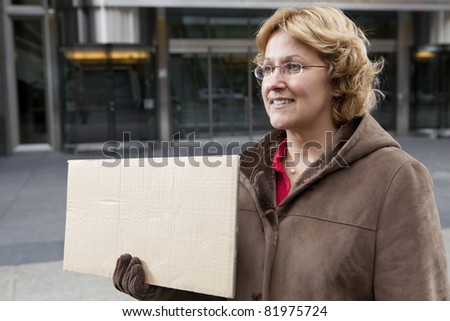 Outdoor business woman with blank sign horizontal - stock photo