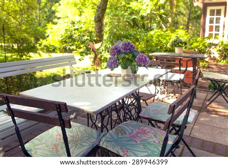 Outdoor cafe in the park.  Europe summer - stock photo