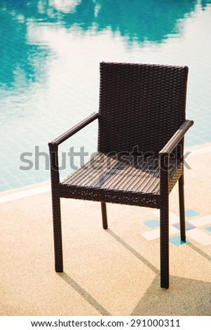 outdoor chair rattan armchairs on swimming pool
