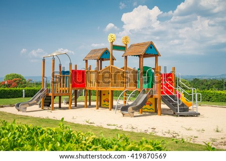 Outdoor children playground in sunny day - stock photo