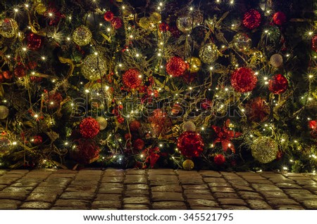 Outdoor Christmas and New year decoration on cobblestone ground - stock photo