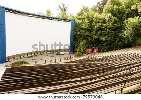 Outdoor cinema stage and empty seats - stock photo