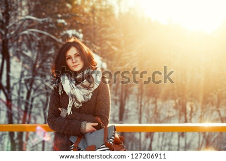 outdoor closeup of young pretty teenage girl in cold weather. - stock photo