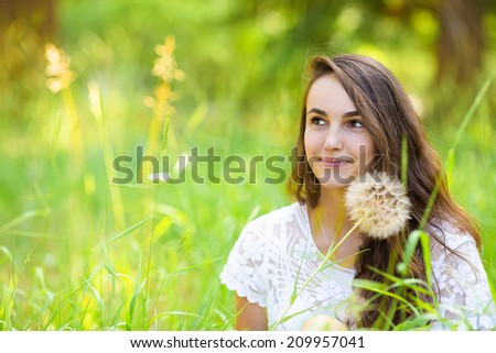 Outdoor closeup portrait beautiful, happy young Girl with Dandelion flower on a sunny summer day. Leisure, vacation, travel concept. Positive facial expressions, emotions, feelings, life perception - stock photo