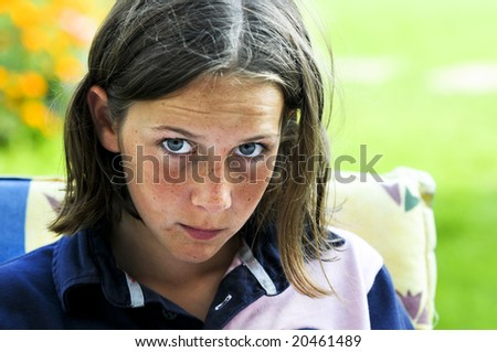 outdoor closeup portrait of girl staring - stock photo