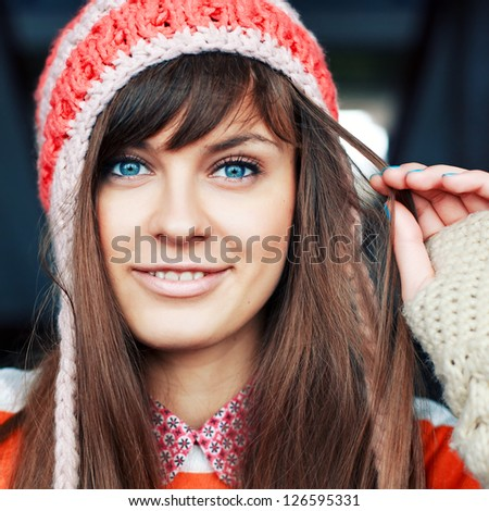 Outdoor closeup portrait of young girl in winter or cold spring - stock photo