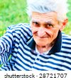 Outdoor colorful portrait of happy bright senior man - stock photo
