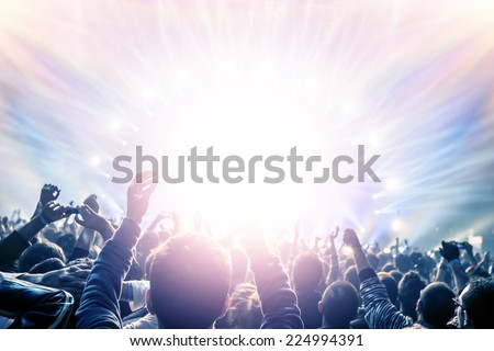 Outdoor concert, happy people with raised up hand enjoying night in the club, night entertainment, active lifestyle, New Year celebration, partying concept - stock photo