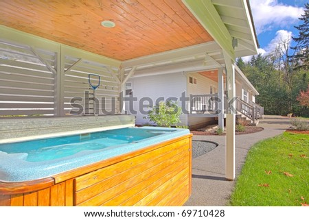 Outdoor covered hot tub - stock photo