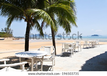 Outdoor dining tables nearby beach