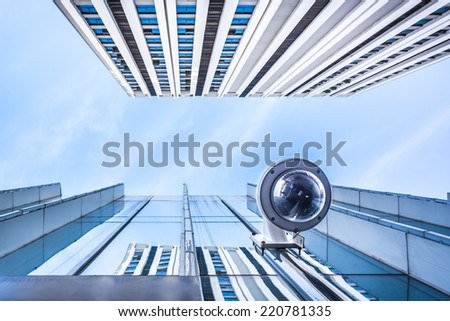 Outdoor Dome Security Camera in a city - stock photo