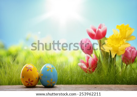 Outdoor easter eggs and spring flowers - stock photo