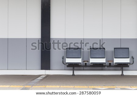 Outdoor empty  passenger seat at train station - stock photo