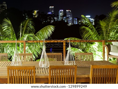 Outdoor entertaining area with beautiful city skyline view - stock photo