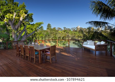 Outdoor entertaining deck with waterfront views - stock photo