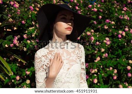 Outdoor fashion art photo of elegant lady in an old European town - stock photo