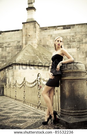 outdoor fashion - beautiful young blond girl - stock photo