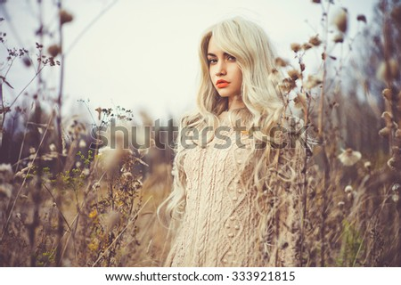 Outdoor fashion photo of young beautiful lady in autumn landscape - stock photo