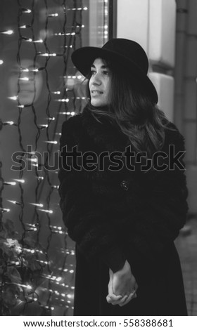 Outdoor fashion portrait of stylish young woman urban city street style black and white