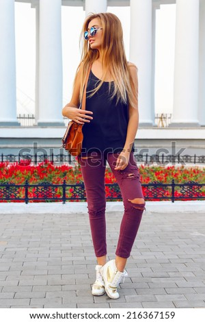 Outdoor fashion portrait of young woman wearing urban coney outfit and sunglasses, have long blonde ombre hairs, Fashion street style. - stock photo