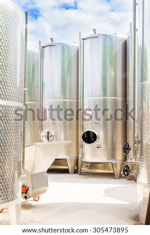 Outdoor fermentation tanks for making wine. - stock photo