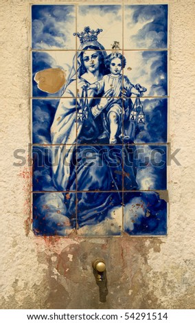 outdoor fountain in Spain with the image of the Madonna with baby Jesus
