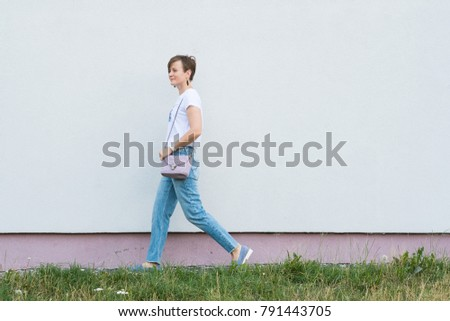 Outdoor full body portrait of young beautiful fashionable woman