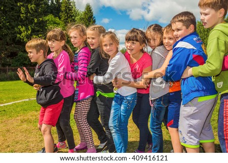 "Outdoor games on the field. Children play the mobile game on the field. ""Tail of the dragon"". Children's camp""Birch""  Russia, Yaroslavl  17.06.2015"