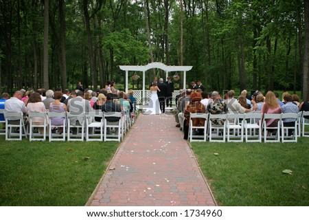 Outdoor garden wedding at a park. - stock photo