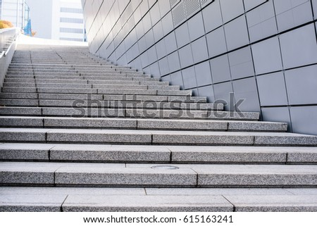 Outdoor Granite Stairs And Metallic Wall Of Modern Building In The City