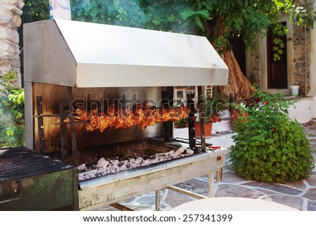 Outdoor grill with roasted meat in the village of Halki.  Naxos, Greece.  - stock photo