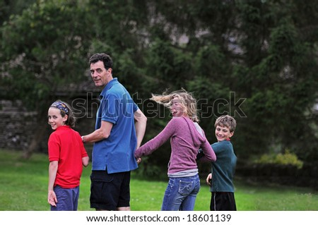 outdoor group portrait of family - stock photo