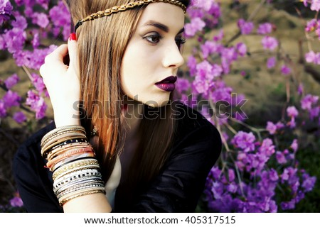 Outdoor high fashion portrait of young woman model, posing with trendy accessories and boho style clothes. Fashion blogger outfit close up. Street style concept photo toned style instagram filters  - stock photo
