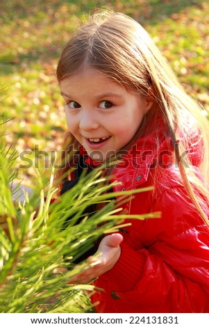 Outdoor image of adorable little girl at autumn park/Beautiful little girl in autumn park - stock photo