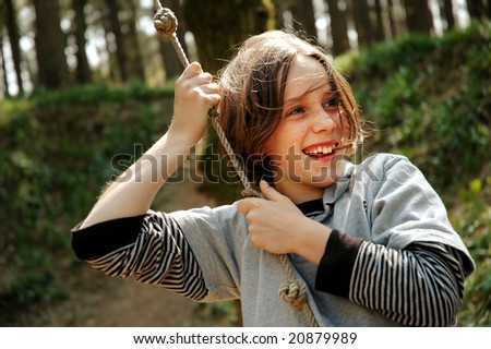 outdoor image of girl on swing - stock photo