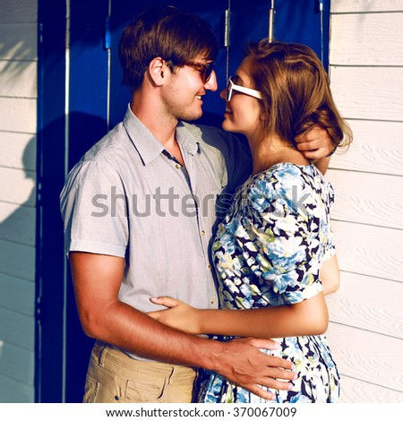 Outdoor image of romantic couple in love, hugs and kisses, vintage clothes, toned colors, sensual style valentine day. - stock photo