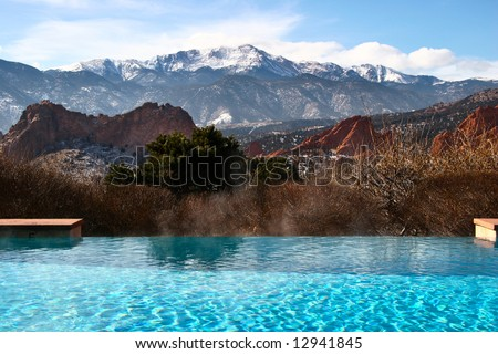 Outdoor infinity pool with a view of Pike's Peak and Garden of the Gods Park in Colorado Springs Colorado USA. - stock photo