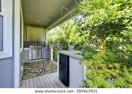 Outdoor kitchen area with decorative zebra rug. - stock photo