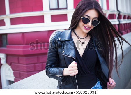 outdoor lifestyle fashion portrait of young stylish hipster woman walking on streetwearing cute trendy