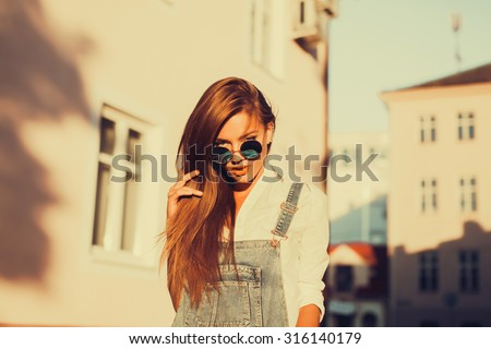 Outdoor Lifestyle fresh portrait of young amazing smiling positive girl, long brunette fluffy hairs, fresh natural make up, natural beauty,stylish clothes and accessorizes,pure beauty - stock photo