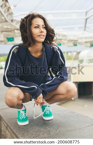 Outdoor lifestyle portrait of hipster teenage girl