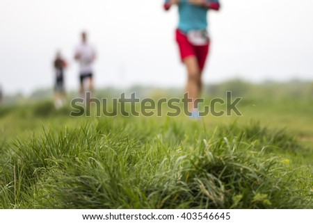 Outdoor marathon cross-country running fitness and healthy lifestyle, blurred motion - stock photo